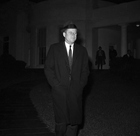 "FILE - In this Dec. 19, 1961 file photo, President John F. Kennedy leaves the White House in Washington to Andrews Air Force Base for flight to Palm Beach, Fla. en route to the bedsite of his father, Joseph P. Kennedy, who is hospitalized after suffering as stroke. Kennedy's civil rights legacy has undergone substantial reassessment since his 1963 assassination. Half a century later, ""We're still trying to figure it out,"" says one longtime civil rights activist. (AP Photo/WJS)"