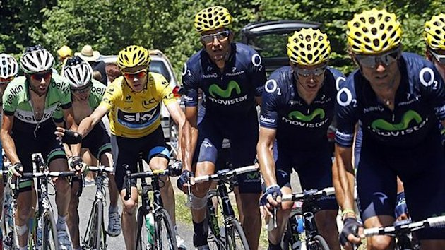 Race leader yellow jersey holder Team Sky rider Christopher Froome of Britain (2ndL) cycles in the pack during the 168.5 km ninth stage of the centenary Tour de France cycling race from Saint-Girons to Bagneres-de-Bigorre July 7, 2013 (Reuters)