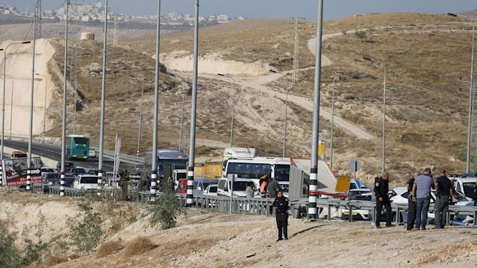 An Israeli policeman guards near the body of a Palestinian, who Israeli police and military said rammed his vehicle into Israeli soldiers and wounded two, in the occupied West Bank