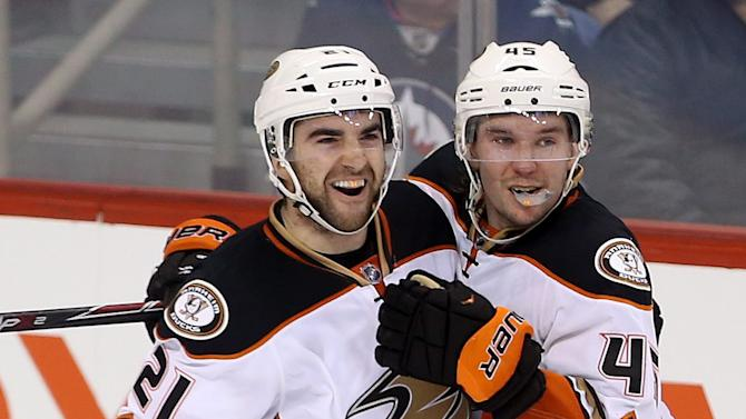 Palmieri leads Ducks over Jets 4-3 in OT