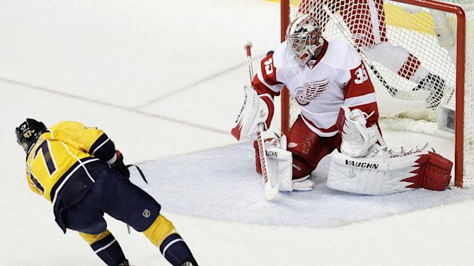 Nashville Predators forward Alexander Radulov (47), of Russia, scores against Detroit Red Wings goalie Jimmy Howard (35) in the first period of Game 5 of a first-round NHL hockey playoff series on Friday, April 20, 2012, in Nashville, Tenn. (AP Photo/Mark Humphrey)