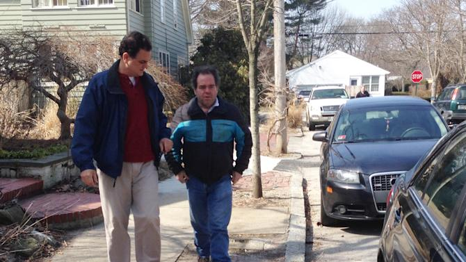 """Rhode Island House Speaker Gordon Fox speaks to a reporter as he emerges from his home in Providence, R.I., on Saturday, March 22, 2014 a day after Fox's home and Statehouse office were raided by federal and state authorities. Fox told reporters outside his home Saturday he would make a statement """"when it's appropriate."""" Authorities raided Fox's Capitol office and home Friday as part of an investigation by the U.S. attorney's office, FBI, IRS and state police. Officials haven't said who or what they are investigating. Fox wouldn't comment when asked if he plans to resign. He also wouldn't say if a lawyer is representing him. (AP Photo/Michelle R. Smith)"""
