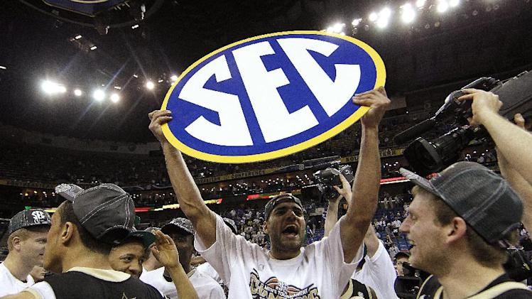 **ADDS NAME OF PLAYER WITH SIGN** Vanderbilt forward Jeffery Taylor, leading scorer, holds up an SEC sign after Vanderbilt won the  2012 Southeastern Conference tournament at the New Orleans Arena in New Orleans, Sunday, March 11, 2012. Vanderbilt beat Kentucky 71-64. (AP Photo/Gerald Herbert)