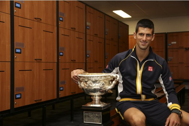 Novak Djokovic of Serbia poses in the locker room with the Norman Brookes Challenge Cup after defeating Andy Murray of Britain in their men's singles final match at the Australian Open tennis tourname