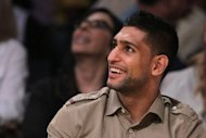 Golden Boy Promotions has asked boxing commissioners in Washington to turn English fighter Amir Khan's loss to Lamont Peterson into a no-contest result, ESPN reported on Saturday