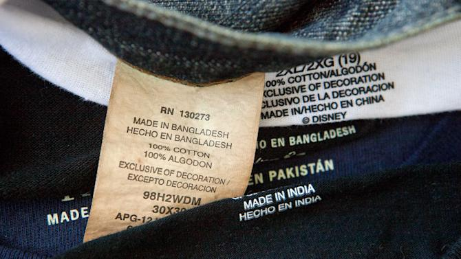 FILE - This Dec. 13, 2012 file photo shows labels of garments made in Bangladesh, India, China and Pakistan, that were purchased at a Wal-Mart store in Atlanta. President Barack Obama said Thursday, June 27, 2013, it is suspending U.S. trade privileges for Bangladesh because of concerns over labor rights and worker safety that intensified after hundreds died there in the global garment industry's worst accident. (AP Photo/David Goldman, File)