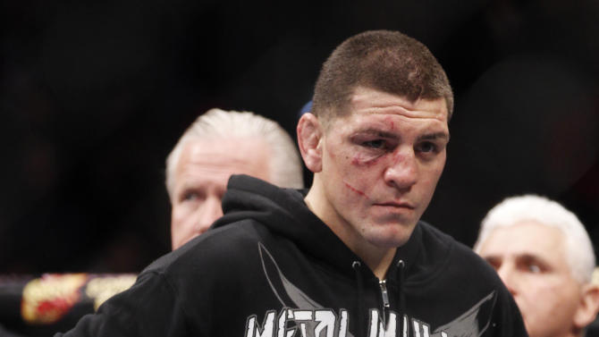 FILE - In this Feb. 4, 2012, file photo, Nick Diaz stands after Carlos Condit won a unanimous decision in their UFC welterweight mixed martial arts bout in Las Vegas. The head of the Nevada Athletic Commission says Diaz tested positive for marijuana after his recent loss to Condit and faces disciplinary action, including a possible suspension and fine. Executive director Keith Kizer said Thursday, Feb. 9, 2012. that Diaz's license has been temporarily suspended and he will have 20 days to respond to the allegations. (AP Photo/Eric Jamison, File)
