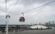 The 'Emirates Air Line' cable car system pictured above the O2 Arena in east London on June 28, 2012. The cable car has been strung over the Thames, an athletes' terminal built at Heathrow Airport, and Olympic traffic lanes set up -- yet Londoners still fear the Games will bring their city to a standstill