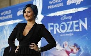"""Singer Lovato, who is featured on the soundtrack, poses at the premiere of """"Frozen"""" at El Capitan theatre in Hollywood"""