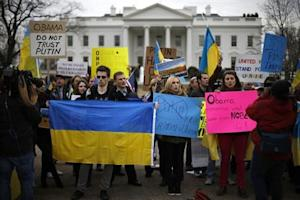 Protesters call for U.S. action against possible Russian incursions into Ukraine, in front of the White House in Washington
