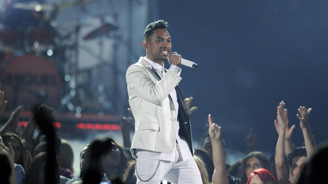 Miguel performs at the Billboard Music Awards at the MGM Grand Garden Arena on Sunday, May 19, 2013 in Las Vegas. (Photo by Chris Pizzello/Invision/AP)