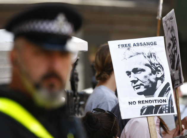"Police look on as demonstrators protest outside the Ecuadorian embassy, London, Wednesday June 20, 2012. WikiLeaks founder Julian Assange entered the embassy Tuesday in an attempt to gain political asylum. Ecuador said Assange would ""remain at the embassy, under the protection of the Ecuadorean government"" while authorities in the capital, Quito, considered his case. Assange was arrested in London in December 2010 at Sweden's request. Since then he has been fighting extradition to the Scandinavian country, where he is wanted for questioning over alleged sexual assaults on two women in 2010. (AP Photo/Tim Hales)"