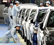 Workers check paints and bodies of Toyota Motor&#39;s best selling car Corolla at a plant of the company&#39;s subsidiary Central Motor at Ohira village in Miyagi prefecture, northern Japan. Toyota announced a global recall of 7.43 million vehicles, including its popular Camry and Corolla models, over a possible fire risk, in a fresh blow to the firm&#39;s reputation for safety