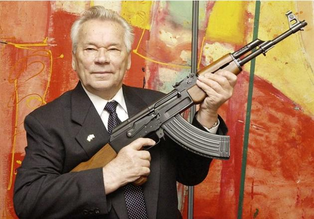 "FILE - In this July 26, 2002 file photo, Russian weapon designer Mikhail Kalashnikov presents his legendary assault rifle to the media while opening the exhibition ""Kalashnikov - legend and curse"