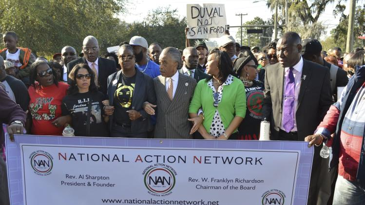 Rev. Al Sharpton marches with mother of Trayvon Martin against Stand Your Ground law in Tallahassee, Florida