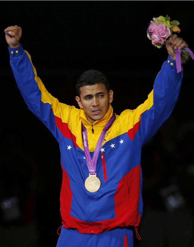 Venezuela's gold medallist Ruben Limardo Gascon celebrates during the men's epee individual fencing competition victory ceremony at the London 2012 Olympic Games