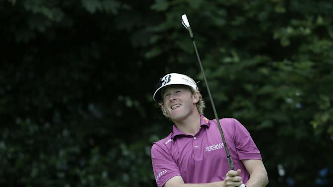 Brandt Snedeker of the United States plays a shot off the first tee at Royal Lytham & St Annes golf club during the final round of the British Open Golf Championship, Lytham St Annes, England Sunday, July  22, 2012. (AP Photo/Chris Carlson)