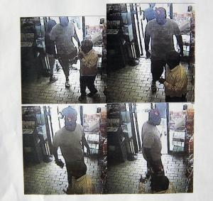 These images provided by the Ferguson Police Department show security camera footage from a convenience store in Ferguson, Mo., on Aug. 9, 2014, the day that Michael Brown was fatally shot by a police officer. A report released Friday, Aug. 15, 2014, by Ferguson Police Chief Thomas Jackson says the footage shows a confrontation between Brown and an employee at the store. The report says that Brown and his friend, Dorian Johnson, stole a box of cigars from the store shortly before Brown's death. (AP Photo/Ferguson Police Department)