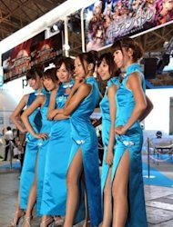 Models line up to greet guests at the annual Tokyo Game Show in Chiba. Sophisticated gameplay and cheap downloads that are fuelling a boom in software for smartphones and tablets were on display Thursday at the Tokyo Game Show, the biggest of its kind in Asia