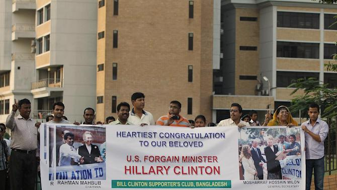 Supporters of U.S. Secretary of State Hillary Clinton line the streets as her motorcade makes its way through the streets of Dhaka, Bangladesh Saturday May 5, 2012.  (AP Photo/Shannon Stapleton, Pool)
