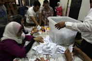 Egyptian election officials counts vote at a polling station in Cairo. Egypt&#39;s ruling military council on Sunday issued an amended constitutional document handing it sweeping powers, including legislative control, after a court ruled the elected parliament invalid