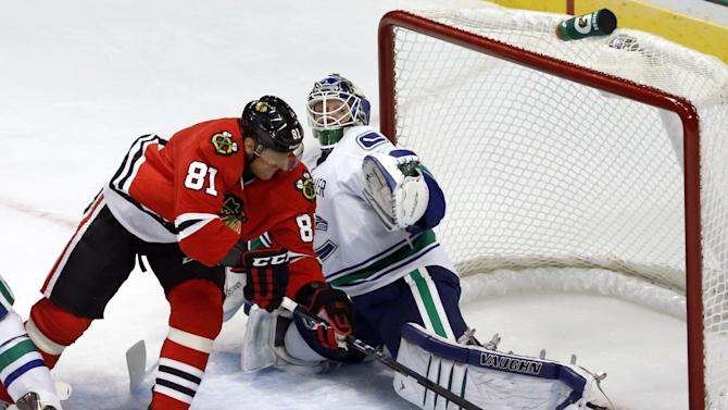 Chicago Blackhawks right wing Marian Hossa (81), from Slovakia, skates past Vancouver Canucks goalie Cory Schneider to score his second goal in the second period of an NHL hockey game Tuesday, Feb. 19, 2013 in Chicago. (AP Photo/Charles Rex Arbogast)
