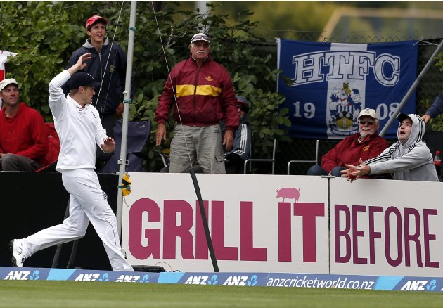 England's Compton watches a spectator drop the ball on the boundary from a six hit by New Zealand's Southee during the third day of the first test in Dunedin