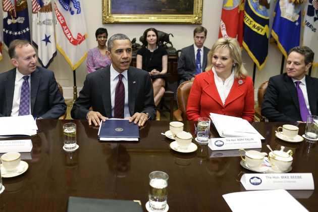 &lt;p&gt;               President Barack Obama, flanked by National Governors Association (NGA) Chairman, Delaware Gov. Jack Markell, left, and NGA Vice Chair, Oklahoma Gov. Mary Fallin, meets with the NGA executive committee regarding the fiscal cliff, Tuesday, Dec. 4, 2012, in the Roosevelt Room at the White House in Washington. Treasury Secretary Tim Geithner is at right. (AP Photo/Charles Dharapak)