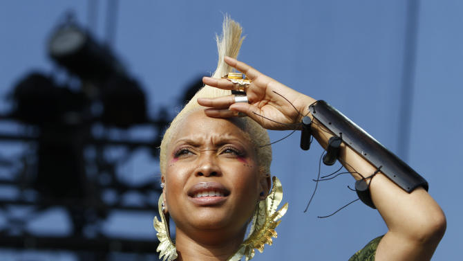 FILE - In this Sunday, Aug. 8, 2010 file photo, Erykah Badu performs during the Lollapalooza music festival in Grant Park in Chicago. Muslim-majority Malaysia has banned a planned concert by Badu after a photograph appeared showing the Grammy-winning singer with the Arabic word for Allah written on her body. The American R&B singer had been scheduled to perform Wednesday, Feb. 29, 2012. in Kuala Lumpur. (AP Photo/Nam Y. Huh, File)