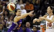 Seattle Storm's Sue Bird (10) passes beyond Phoenix Mercury's Samantha Prahalis in the first half of a WNBA basketball game, Thursday, Aug. 16, 2012, in Seattle. (AP Photo/Elaine Thompson)