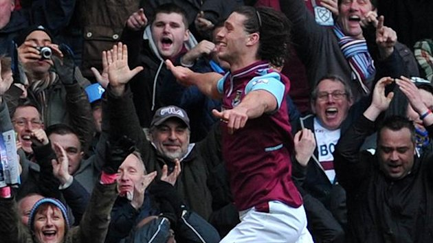 West Ham's English striker Andy Carroll celebrates after scoring the opening goal of the English Premier League football match between West Ham United and West Bromwich Albion at Upton Park in east London on March 30, 2013 (AFP)