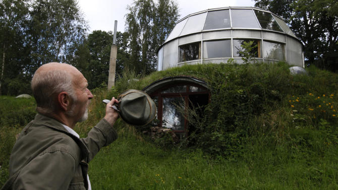 Lhota, a 73-year-old builder, stands in front of the house which he built in Velke Hamry