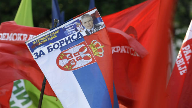 """A supporter of Pro-Western former Serbian President and presidential candidate Boris Tadic waves with Serbian flag reading: """"For Boris"""" during a final pre-election rally in Belgrade, Serbia, Wednesday, May 2, 2012. Serbia's bid to join the European Union will be tested this weekend at a general election pitting ruling pro-European Union reformists against nationalists seeking closer ties with Russia. (AP Photo/Darko Vojinovic)"""