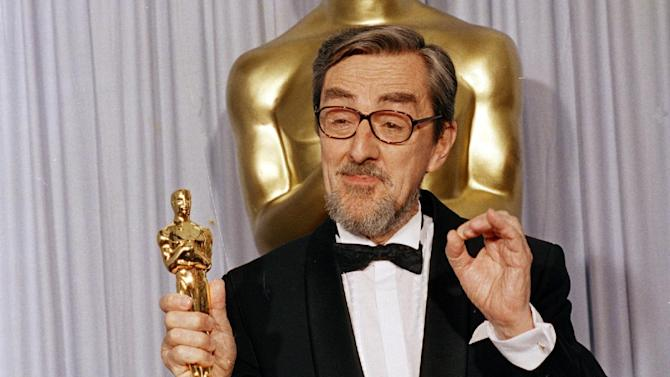 "FILE - In this Monday, April 12, 1988 file photo, Gabriel Axel gestures backstage at the Shrine Auditorium in Los Angeles after winning an Oscar for Best Foreign Language at the Academy Awards. Gabriel Axel, the first Dane to win an Oscar for best foreign film as of ""Babette's Feast,"" has died at the age of 95. His daughter Karin Moerch said in an email statement acquired by The Associated Press that he died Sunday, Feb. 9, 2014 ""quietly and peacefully after a long and eventful life."" He did not say where, nor did she give the cause of death. (AP Photo/Lennox McLendon, File)"
