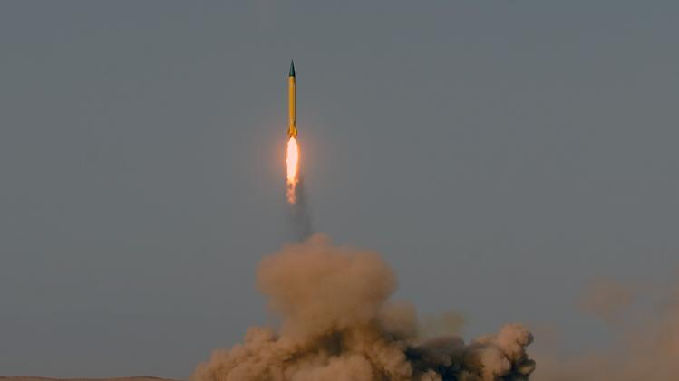 In this photo provided by the Iranian Students News Agency (ISNA), a surface-to-surface missile is launched during the Iranian Revolutionary Guards maneuver in an undisclosed location in Iran, Tuesday, July 3, 2012. Iran's powerful Revolutionary Guards test fired several ballistic missiles on Tuesday, including a long-range variety capable of hitting U.S. bases in the region as well as Israel, Iranian media reported. (AP Photo/ISNA, Alireza Sot Akbar) THE ASSOCIATED PRESS HAS NO WAY OF INDEPENDENTLY VERIFYING THE CONTENT, LOCATION OR DATE OF THIS IMAGE.