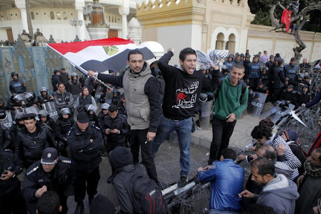 Egyptians shout slogans during an anti-President Mohammed Morsi protest in front of the presidential palace in Cairo, Egypt, Friday, Feb. 1, 2013. Thousands of Egyptians marched across the country, ch