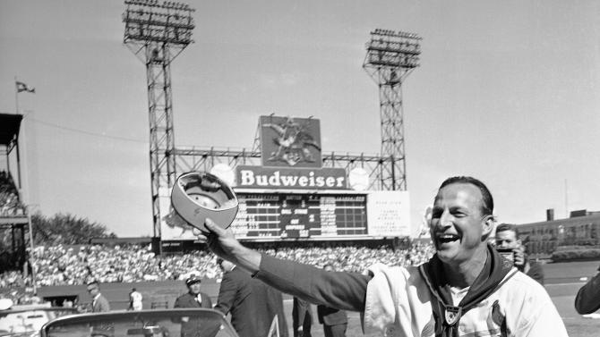 FILE - In this Sept. 29, 1963 file photo, St. Louis Cardinals' Stan Musial waves to fans during ceremonies marking the his last game as a player before a baseball game against the Cincinnati Reds in St. Louis. Musial, one of baseball's greatest hitters and a Hall of Famer with the Cardinals for more than two decades, died Saturday, Jan. 19, 2013, the team announced. He was 92. (AP Photo/File)