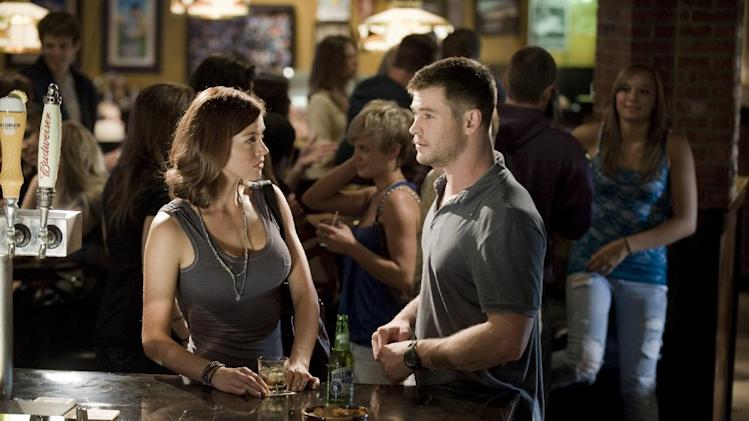 """This film image released by Film District shows Adrianne Palicki, left, and Chris Hemsworth in a scene from """"Red Dawn."""" (AP Photo/Film District)"""