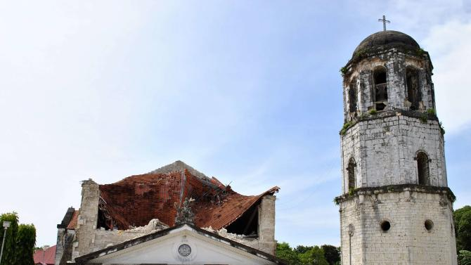 The collapsed facade of the Holy Trinity Parish in Loay Town is seen after an earthquake struck Bohol province