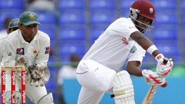 West Indies' Darren Bravo, right, edges a ball as Pakistan's wicket keeper Mohammad Salman looks on