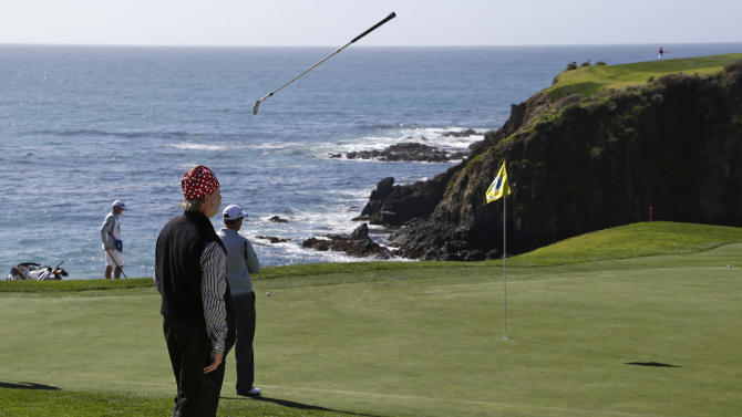 Actor Bill Murray tosses his wedge after chipping onto the eighth green of the Pebble Beach Golf Links during the third round of the AT&T Pebble Beach Pro-Am golf tournament Saturday, Feb. 9, 2013, in Pebble Beach, Calif. (AP Photo/Eric Risberg)