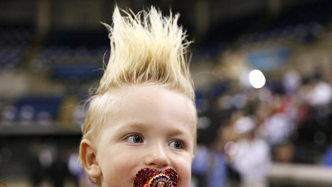 19-month-old Curtis Ray Jeffery II, of Louisiana, wears a pacifier with U.S. presidential candidate Donald Trump's image on it before a rally in Baton Rouge, Louisiana