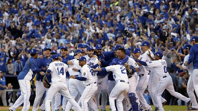 FILE - In this Wednesday, Oct. 15, 2014 file photo, the Kansas City Royals players celebrate after the Royals defeated the Baltimore Orioles 2-1 in Game 4 of the American League baseball championship series in Kansas City, Mo. The Royals advance to the World Series. The Kansas City Royals went on a post-season winning streak that took them to their first World Series since 1985 but fell to the San Francisco Giants in Game 7 is one of the top stories in 2014. (AP Photo/Matt Slocum , File)