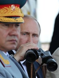 Russian President Vladimir Putin (R) and Defence Minister Sergei Shoigu watch the Navy Day parade in Sevastopol, on July 28, 2013, during a visit in Ukraine. The defense and foreign ministers of Russia and the United States meet in Washington on Friday to brave the chill that has descended on ties between the former Cold War rivals.