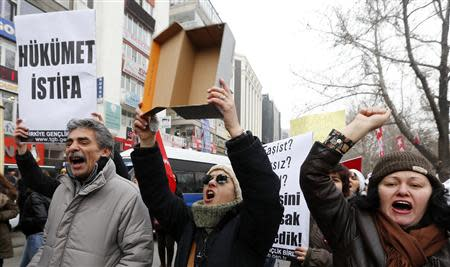 A demonstrator holds a shoe box during a demonstration against Turkey's ruling Ak Party and PM Erdogan in Ankara