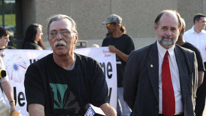 Jeff Mizanskey, left, speaks after being released from the Jefferson City Correctional Center, after serving two decades of a life sentence for a marijuana-related charge in Jefferson City, Mo., on Tuesday, Sept. 1, 2015.  His release followed years of lobbying by relatives, lawmakers and others who argued that the sentence was too stiff and that marijuana should not be forbidden.   (AP Photo/Columbia Missourian/Justin L. Stewart)  MANDATORY CREDIT