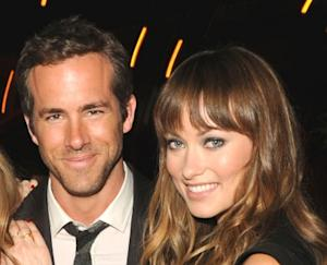 Ryan Reynolds and Olivia Wilde are all smile at the Details Magazine/ Ryan Reynolds Party held at Dominick's Restaurant in Los Angeles on June 6, 2011  -- Getty Images