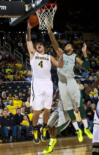 No. 2 Michigan rolls past Eastern Michigan 93-54