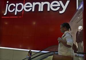 Customers ride the escalator at a J.C. Penney store in New York