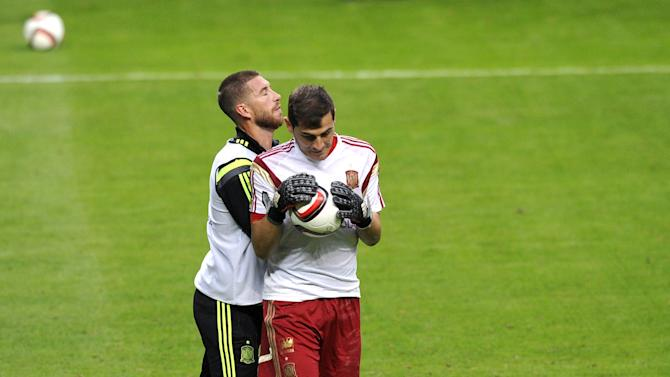 Spanish national goalkeeper Casillas and Ramos joke during a training session at the Carlos Tartiere stadium in Oviedo
